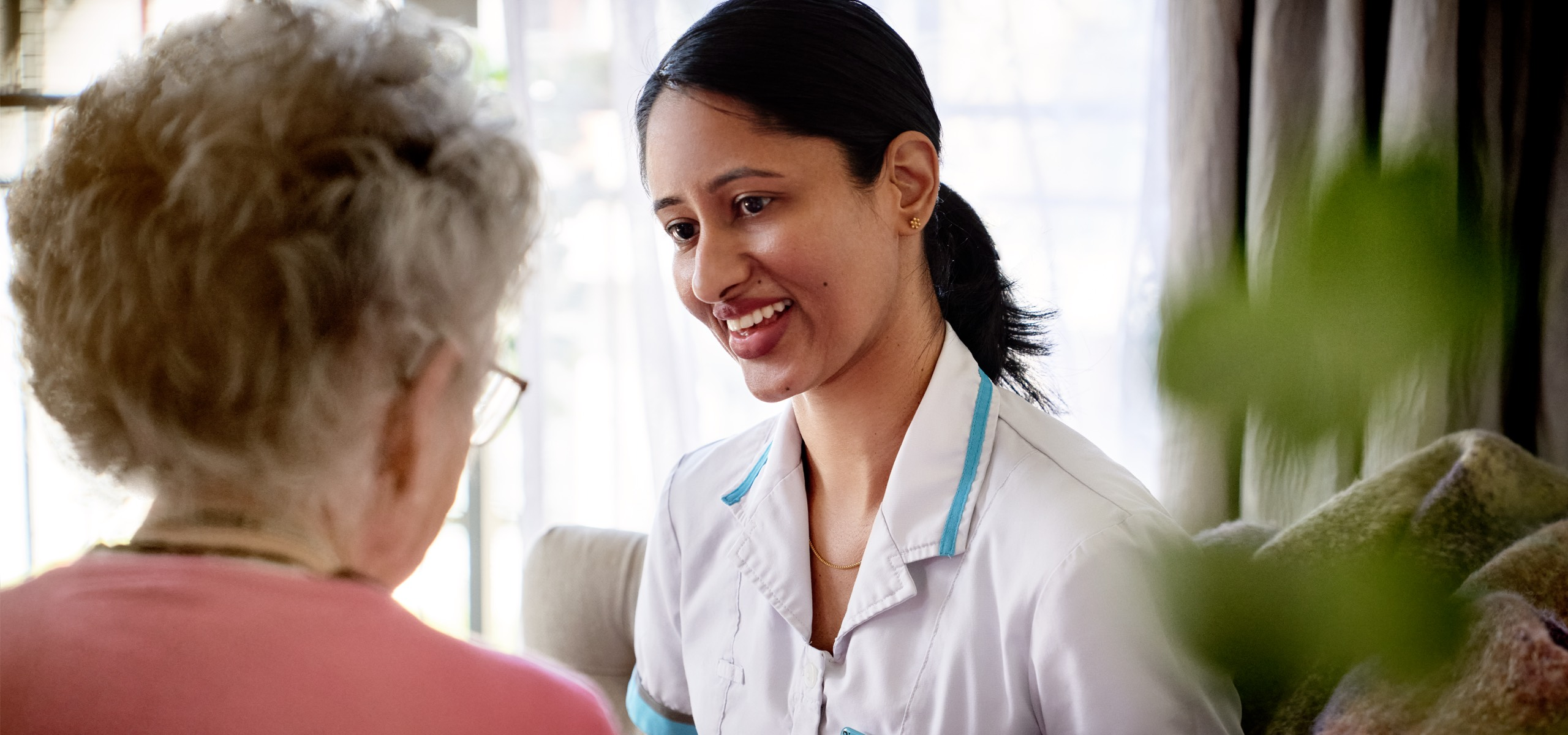 Oceania nurse smiling at resident